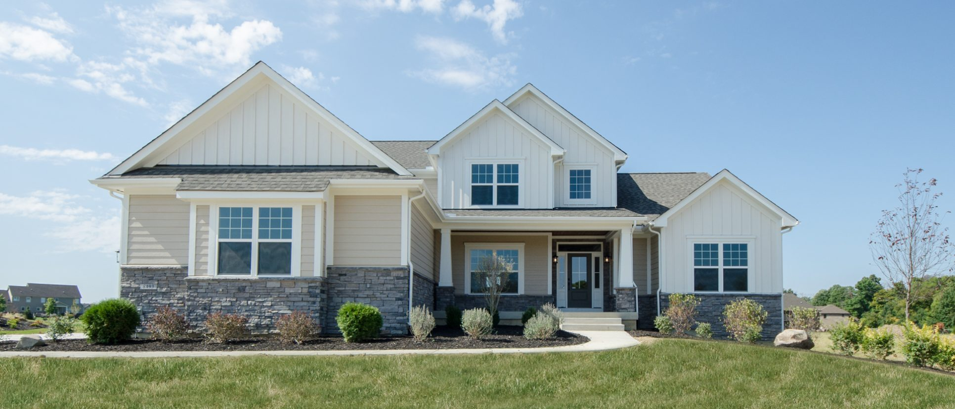 Custom exterior of The Triple Crown. A custom, move-in ready home by Design Homes and Development.