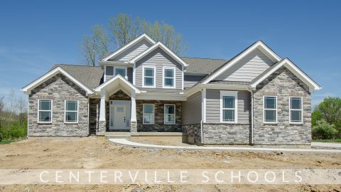 Custom exterior of the Triple Crown in Bridle Creek Ranch. By Design Homes & Development.