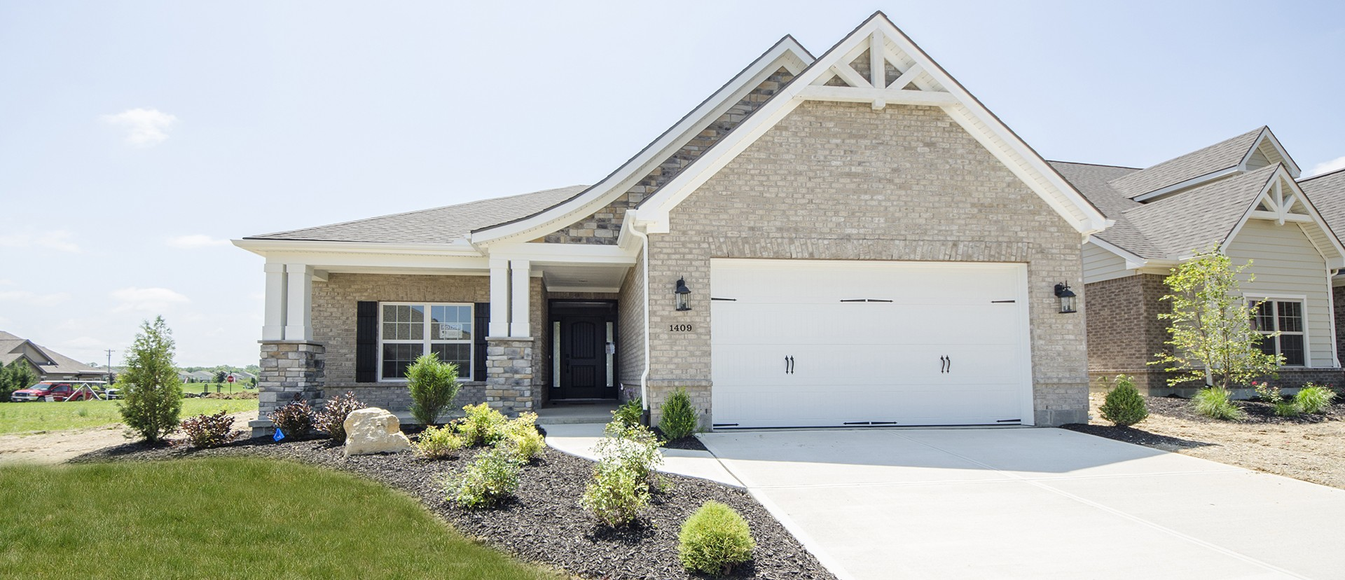 Custom exterior, of The Erica, by Design Homes.