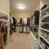 A custom walk-in closet by Design Homes.