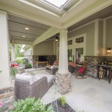 A custom covered patio by Design Homes.