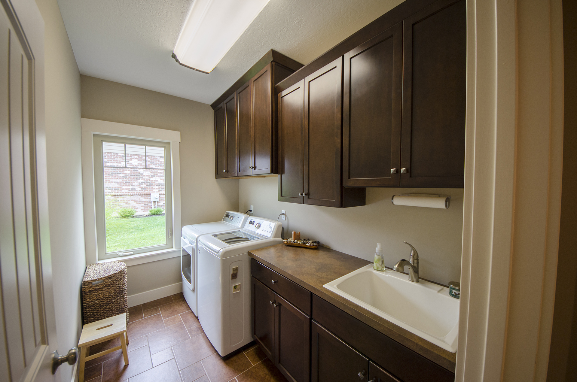 A Custom Laundry Room By Design Homes.