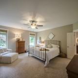 A custom master bedroom by Design Homes.