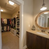 A custom walk-in closet by Design Homes.