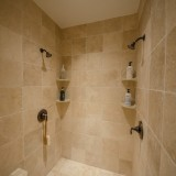A custom master bath shower by Design Homes.