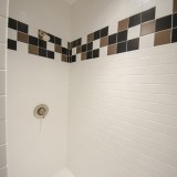 A custom shower by Design Homes.