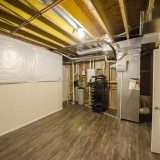 Custom basement in a home in Soraya Farms. Built by Design Homes.