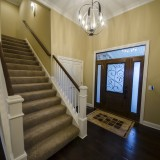 Custom foyer in a home in Soraya Farms. Built by Design Homes.