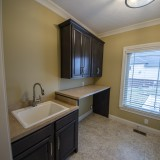 Custom laundry room in a home in Soraya Farms. Built by Design Homes.