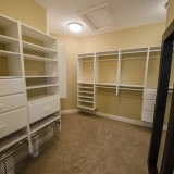 Custom walk-in closet in a home in Soraya Farms. Built by Design Homes.