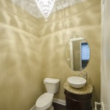 Custom powder room in a home in Soraya Farms. Built by Design Homes.