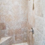 Custom tile shower by Design homes.