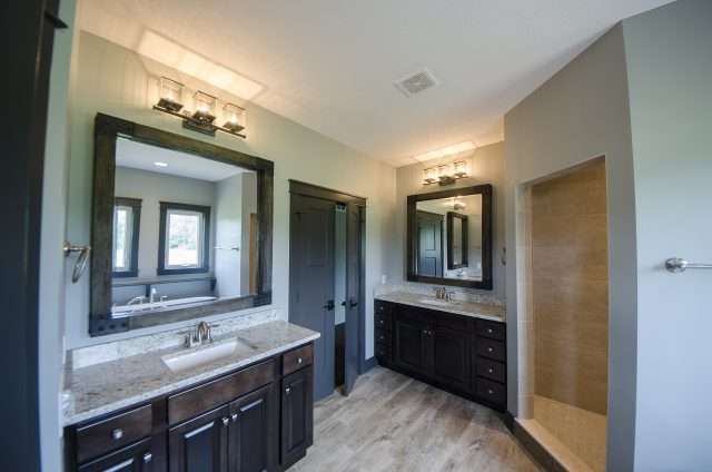 Custom bathroom in The Benjamin with oversized mirrors. A move-in ready home by Design Homes.