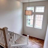 Custom stair well by Design Homes.
