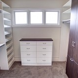 Custom walk-in closet by Design Homes.
