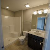 Custom bathroom in The Brighton. A move-in ready home by Design Homes and Development.