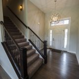 Custom entry in The Brighton. A move-in ready home by Design Homes and Development.