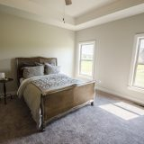Custom master bedroom in The Brighton. A move-in ready home by Design Homes and Development.