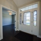 Custom entry in The Charleston. A move-in ready home by Design Homes and Development.
