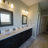 Custom master bathroom in The Charleston. A move-in ready home by Design Homes and Development.