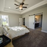 Custom master bedroom in The Charleston. A move-in ready home by Design Homes and Development.