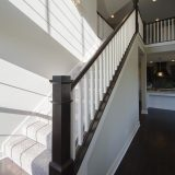 Custom stairwell in The Charleston. A move-in ready home by Design Homes and Development.