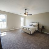 Custom master bedroom in the Jackson. A custom move-in ready home by Design Homes and Development.