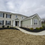 Custom exterior with landscaping by Design Homes.