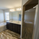 Custom master bathroom by Design Homes in the Marlena.