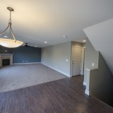 Custom family room and nook by Design Homes in the Marlena.