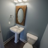 Custom powder room by Design Homes in the Marlena.