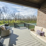 Custom composite deck by Design Homes, overlooking pond in Bridle Creek Ranch.