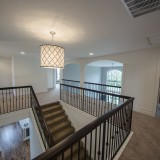 The Reese's custom stairwells by Design Homes.