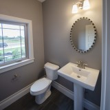 The Reese's custom powder room by Design Homes.