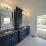 The Reese's custom master bathroom by Design Homes.