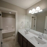 Custom bathroom by Design Homes, custom home builder.