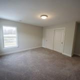 Custom bedroom by Design Homes, custom home builder.