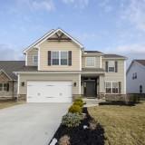 Custom exterior by Design Homes, custom home builder.