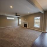 Custom great room by Design Homes, custom home builder.