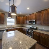 Custom kitchen by Design Homes, custom home builder.