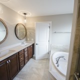 Custom master bathroom by Design Homes, custom home builder.