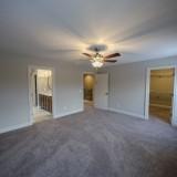 Custom master bedroom by Design Homes, custom home builder.