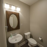 Custom powder room by Design Homes, custom home builder.