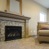 Custom fireplace in the great room by Design Homes.