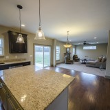 Custom kitchen overlooking the great room by Design Homes.