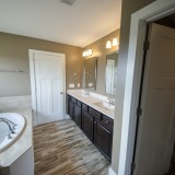 The Sarah custom master bathroom by Design Homes.