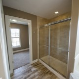Design Homes master bathroom with custom flooring in The Sarah.