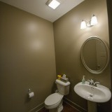 Custom powder room in The Sarah by Design Homes.