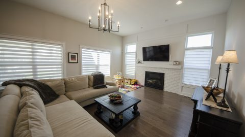 Custom great room, with fireplace, in The Sierra, by Design Homes & Development.