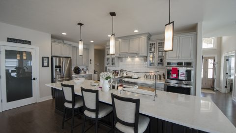 Custom kitchen with island in The Sierra, by Design Homes & Development.